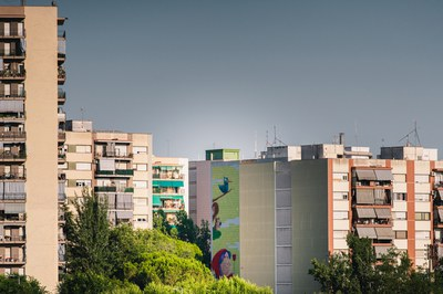 Mural on Plaça Constitució from a distance.
