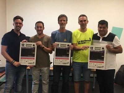 Los regidores de cultura y deportes con los organizadores de La Nocturna (foto: Ayuntamiento de Rubí).